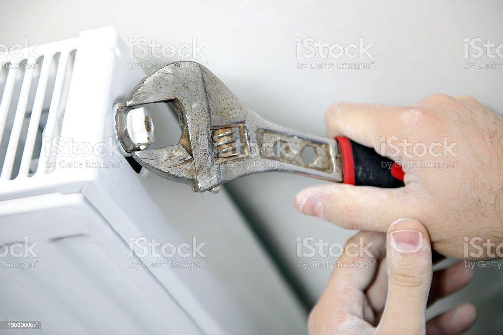 tightening the screw stock photo