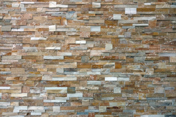 tightly cut stacked slate rock wall distance view stock photo
