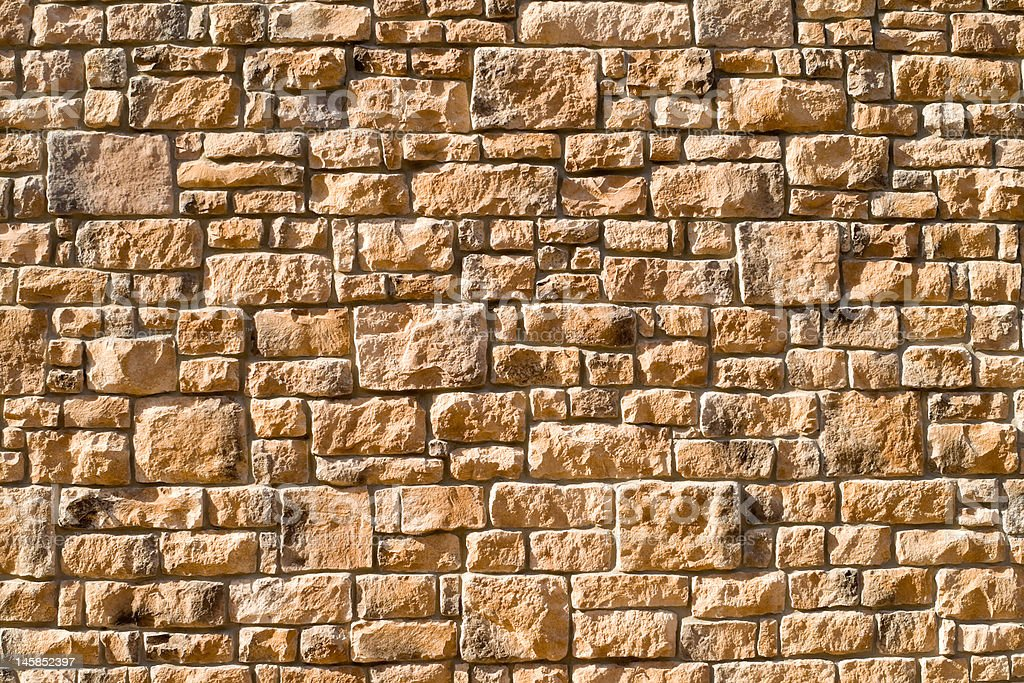 Tightly Packed Full Frame Stone Wall Directional Light stock photo
