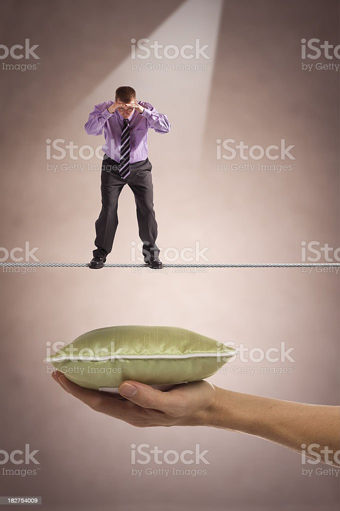Tightrope over pillow of Safety stock photo