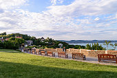 View from Tihany (Hungary) at sunset, with benches and people in the foreground