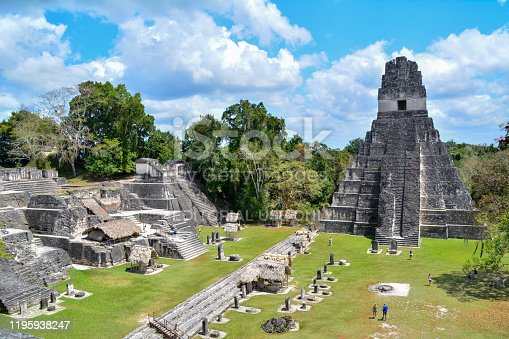 Tikal Ruins, Guatemala 03/11/2015: Overview of the Gran Plaza in the Tikal ruins archaeological national park. Imposing pyramids watch over a large plaza area.