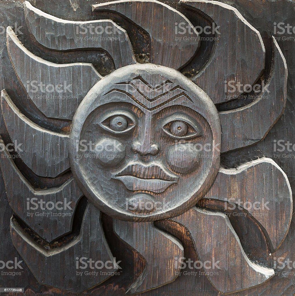 Tiki artwork on wood stock photo