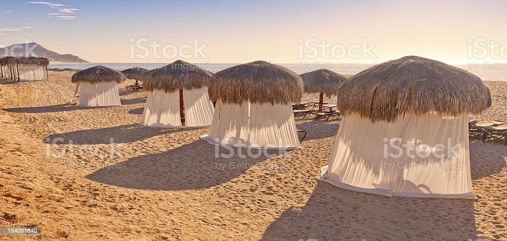 Tiki Huts and Massage Tents on Beach royalty-free stock photo