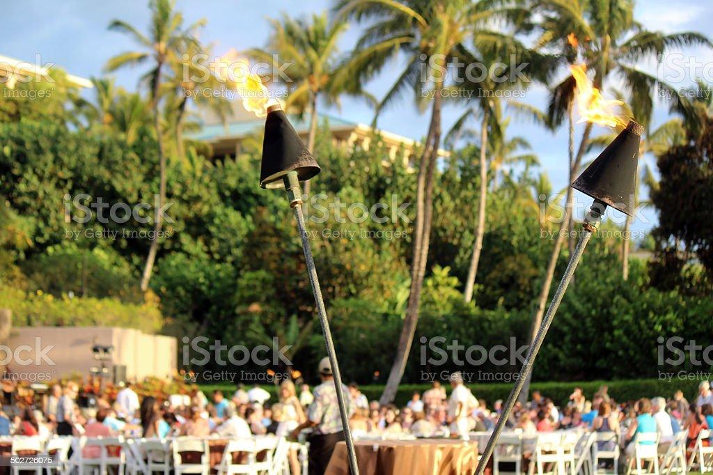 Tiki Torches at Luau stock photo