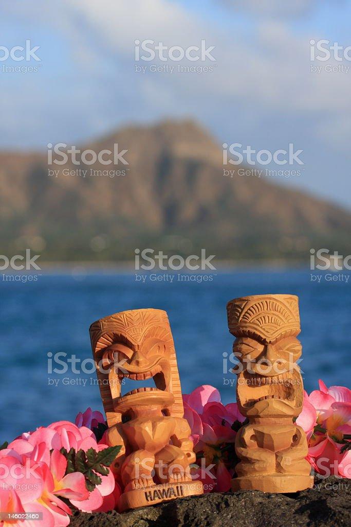 Tikis Hawaii Diamond Head Waikiki Lei Ocean Sunset Sunbathing royalty-free stock photo