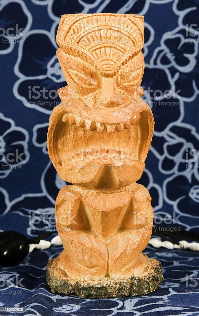 Tikis on Tropical Fabric royalty-free stock photo