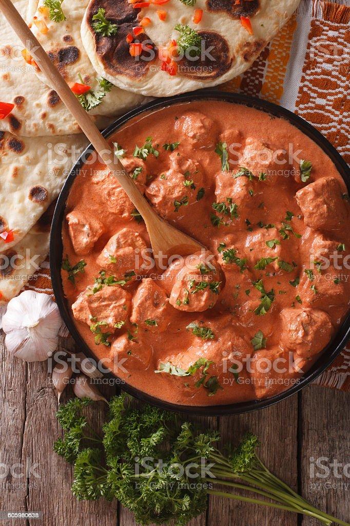 tikka masala chicken and naan flat bread close-up. vertical stock photo