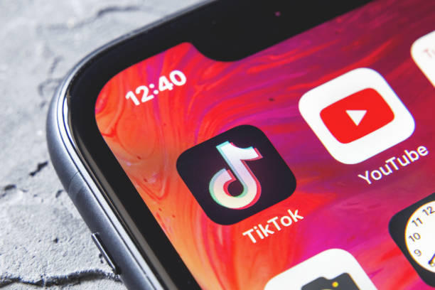 TikTok and YouTube apps on screen iphone xr, close up Tyumen, Russia - April 30,2019: TikTok and YouTube apps on screen iphone xr, close up {{relatedSearchUrl(carousel.phrase)}} stock pictures, royalty-free photos & images