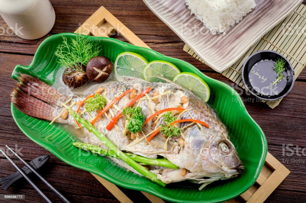 tilapia fish steamed with soy sauce, Thai food. stock photo