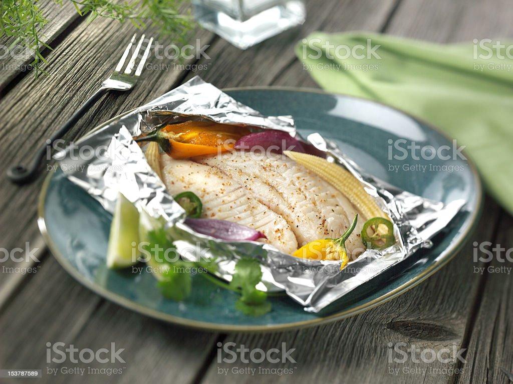 Tilapia in foil royalty-free stock photo