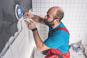 istock Tile contractor laying tiles 1091687810
