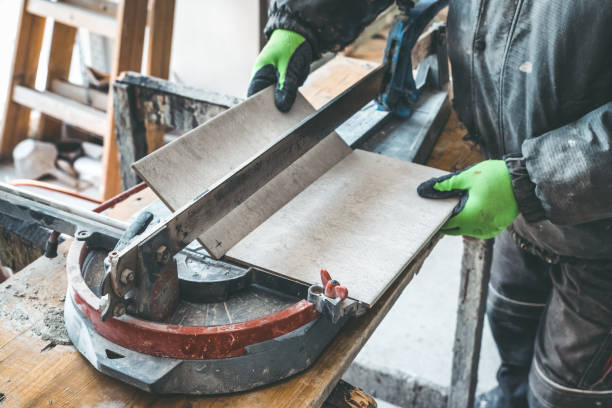 Tile cutter and worker stock photo