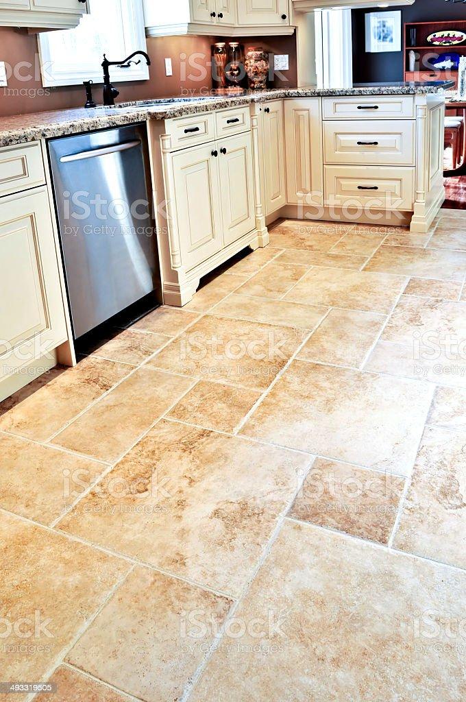 Tile floor in modern kitchen stock photo