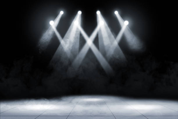 Tile floor with concert spot lighting and smoke Tile floor with concert spot lighting and smoke over dark background stage performance space stock pictures, royalty-free photos & images
