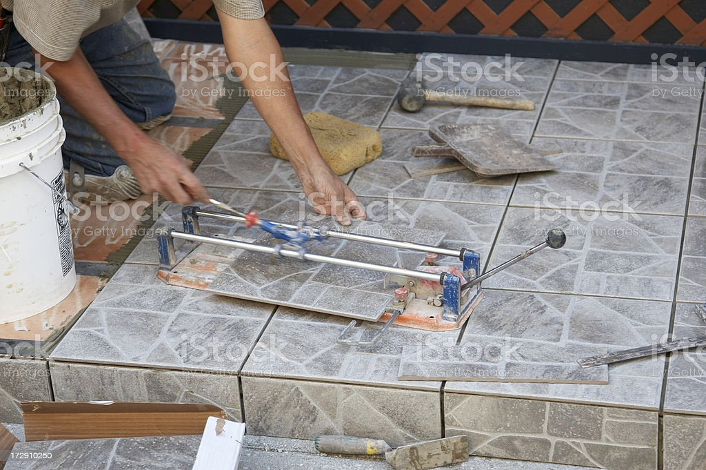 Tile layer at work royalty-free stock photo