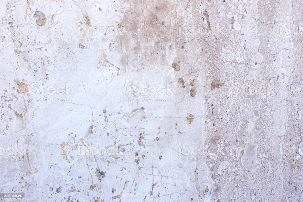 Tile of polished gray limestone as finishing material for exterior of a building stock photo