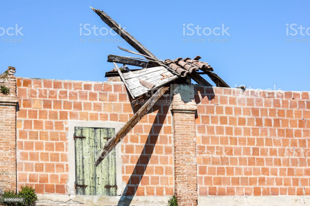 Tile Roof damaged and needing repair stock photo