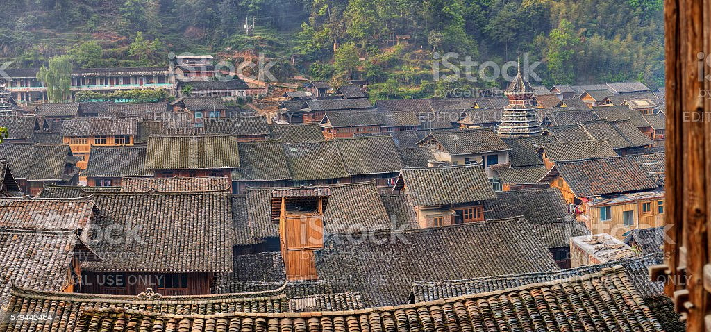 Tile roofs of wooden houses in large ancient chinese village. stock photo