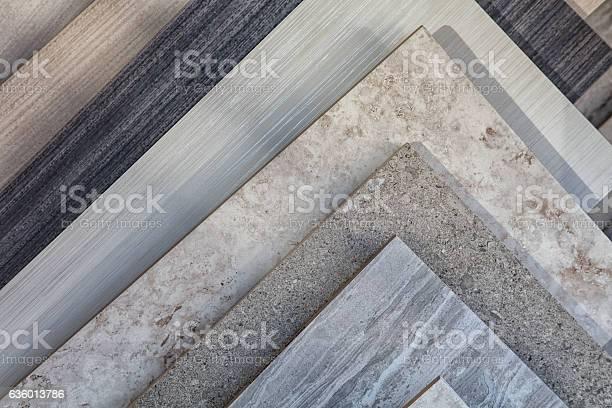 Tile samples in store in rack for display