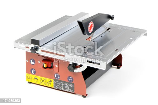 Wet cutting tile saw with warning stickers isolated on white. More pictures...