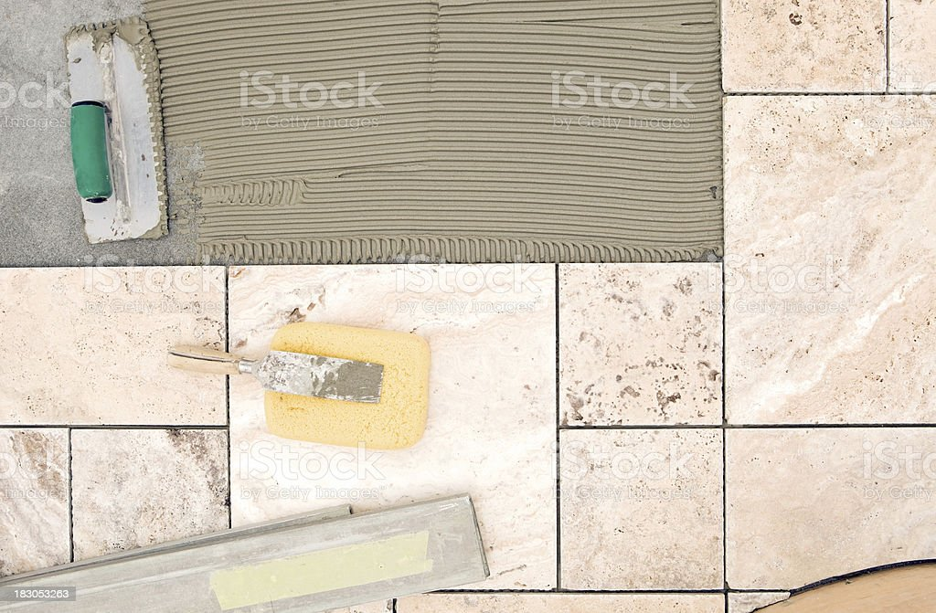 Tile Setter Tools on a New Bathroom Floor royalty-free stock photo
