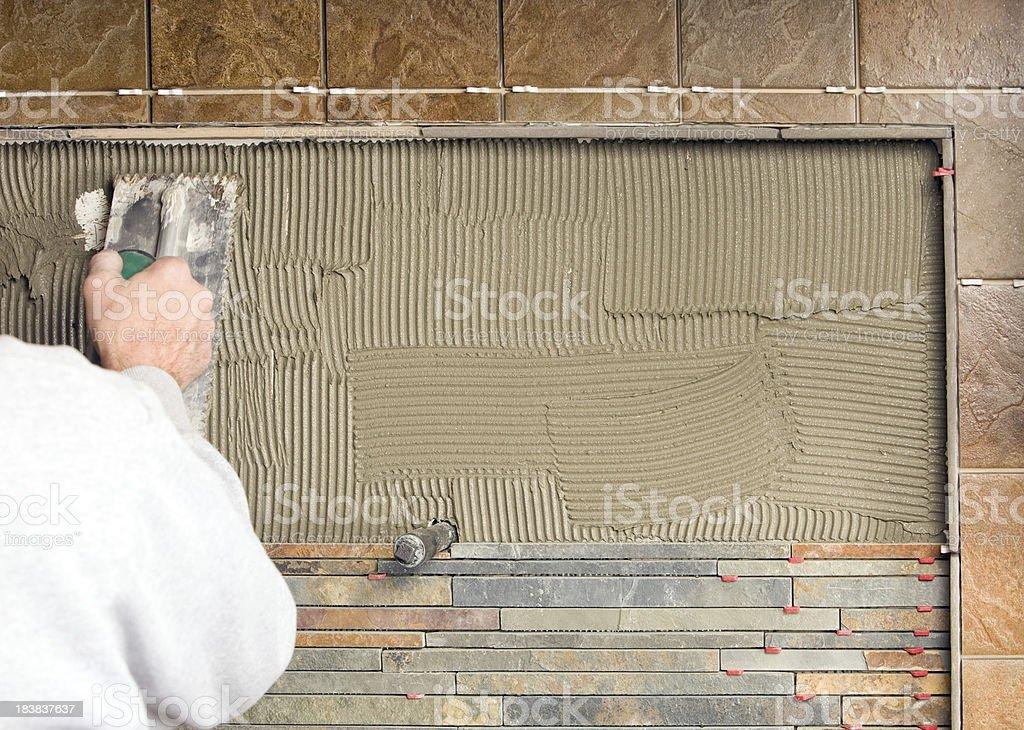Tile Worker Troweling Mortar for a Kitchen Backsplash stock photo