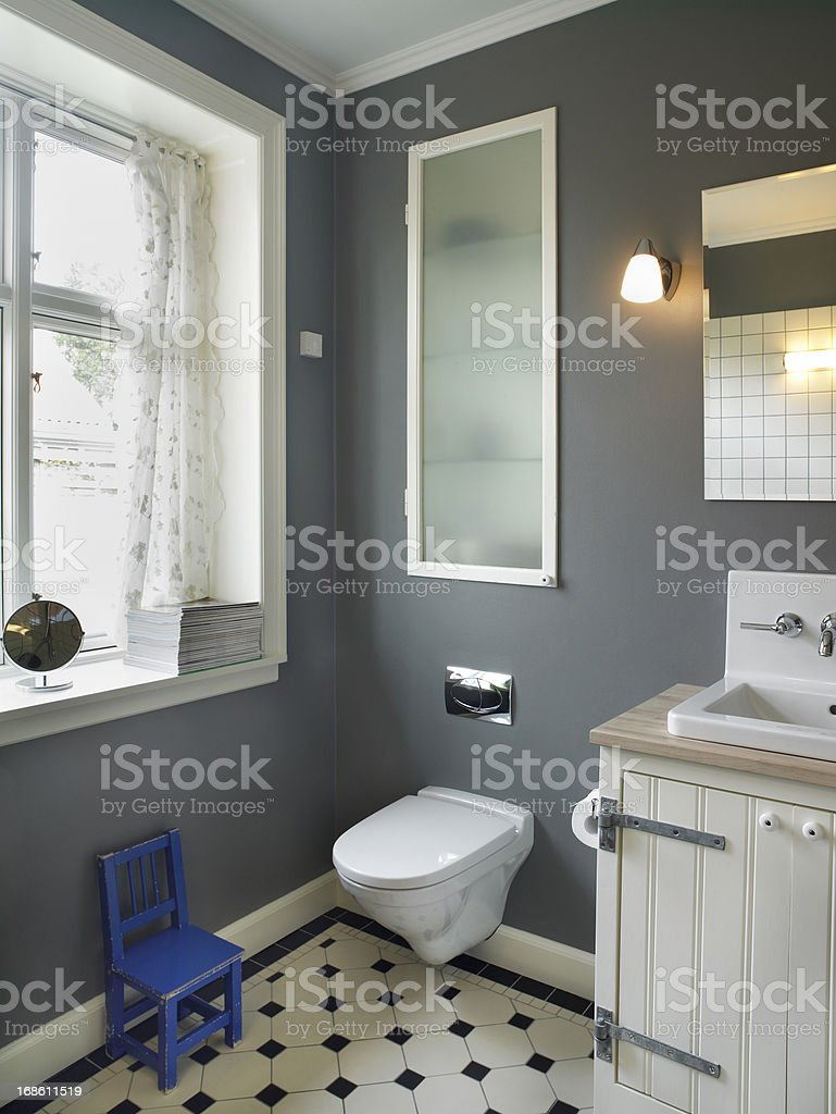 Tiled bathroom Bathroom with wall mounted toilet, and built in cubboard behind glass.. Architectural Feature Stock Photo