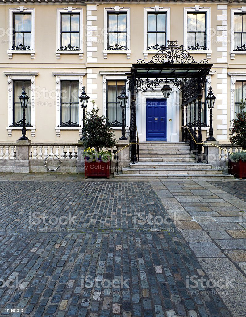 Tiled courtyard of Irish mansion at dusk royalty-free stock photo
