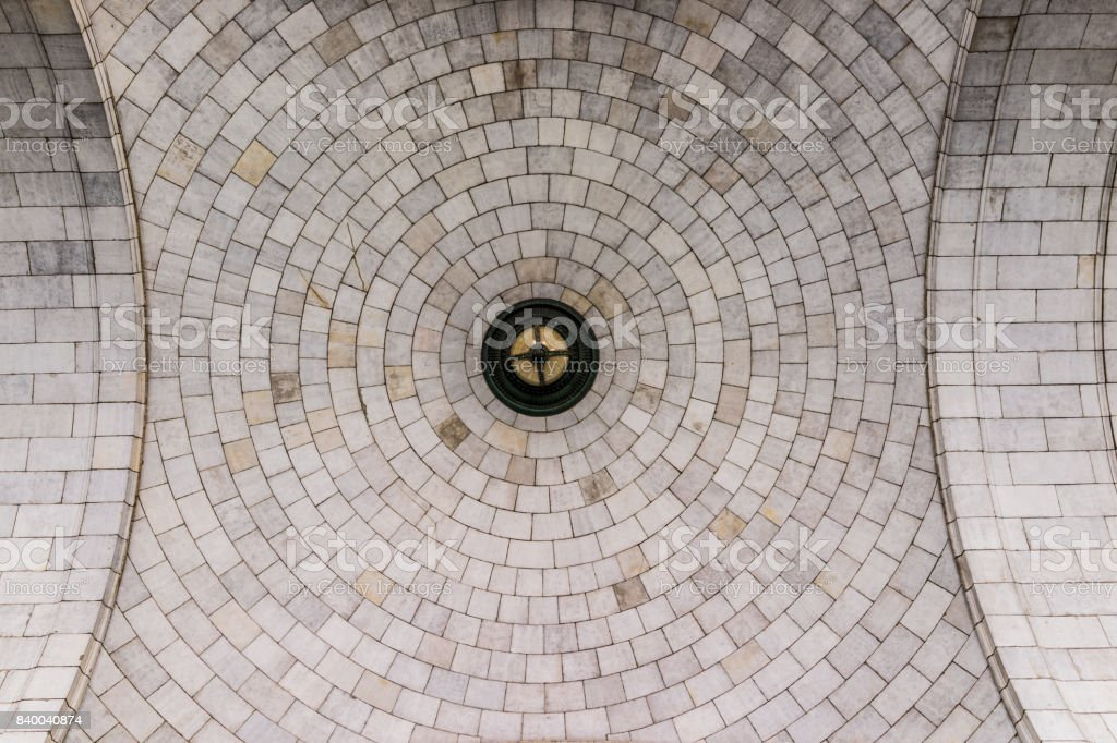 Tiled dome ceiling architecture with symmetrical details looking up stock photo