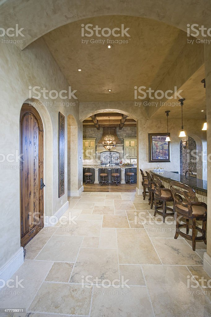 Tiled Floor With Stools At Kitchen Island royalty-free stock photo