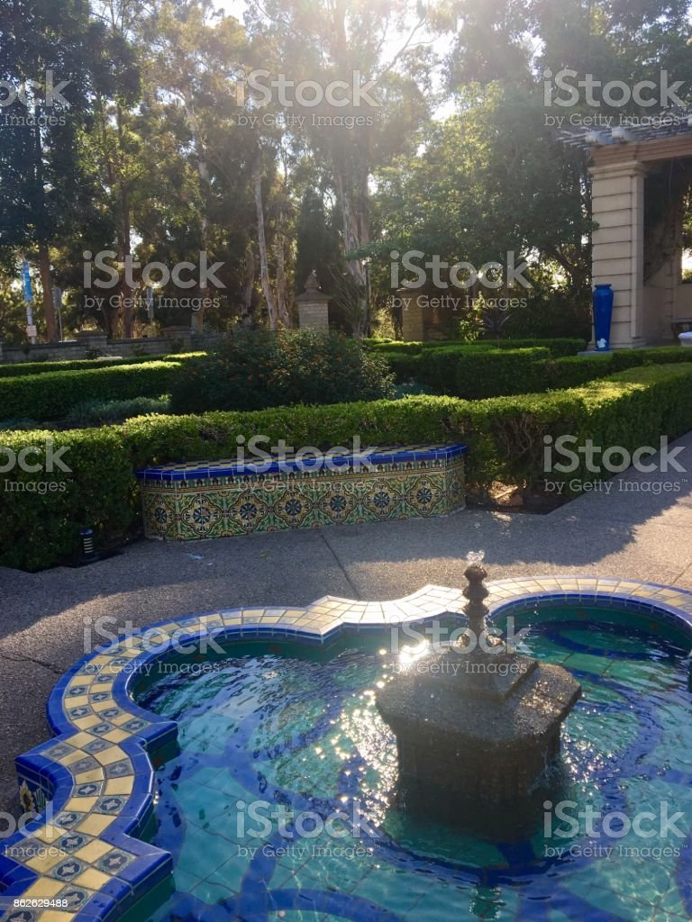 Tiled Fountain and Park Bench stock photo