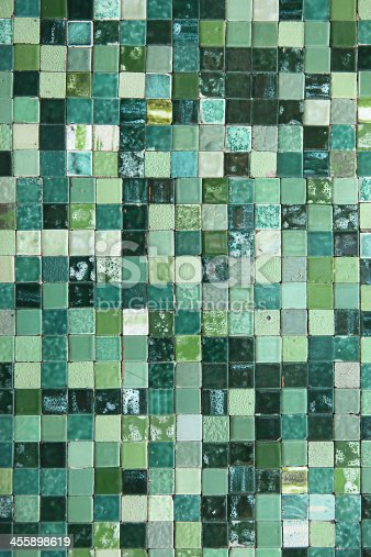 Small traditional Italian tiles in green shades.