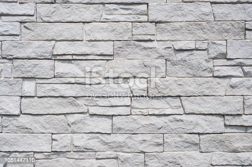 tiled natural stone wall background - granite stone texture