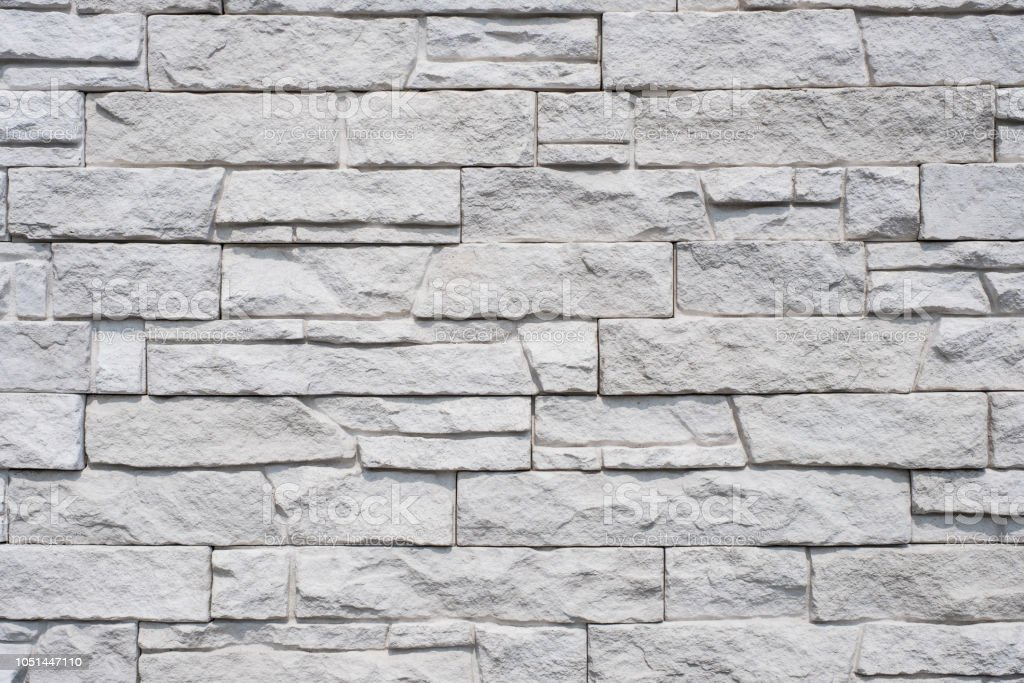 tiled natural stone wall background - granite stone texture stock photo
