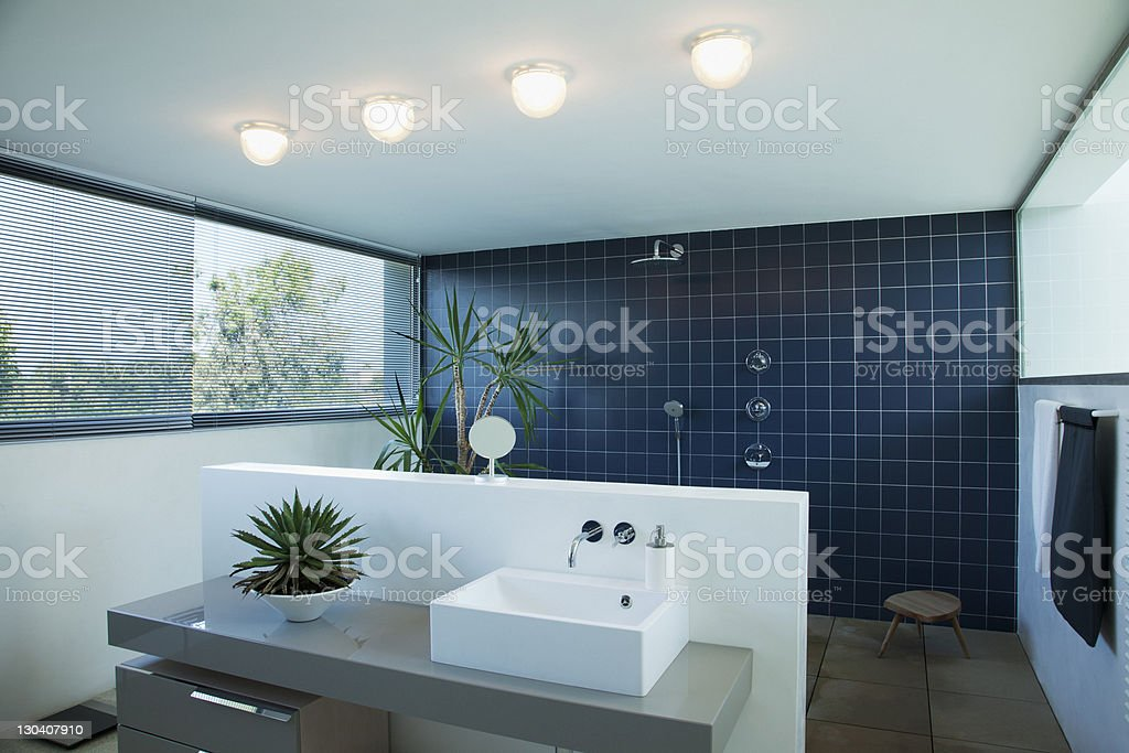 Tiled open shower in modern bathroom stock photo
