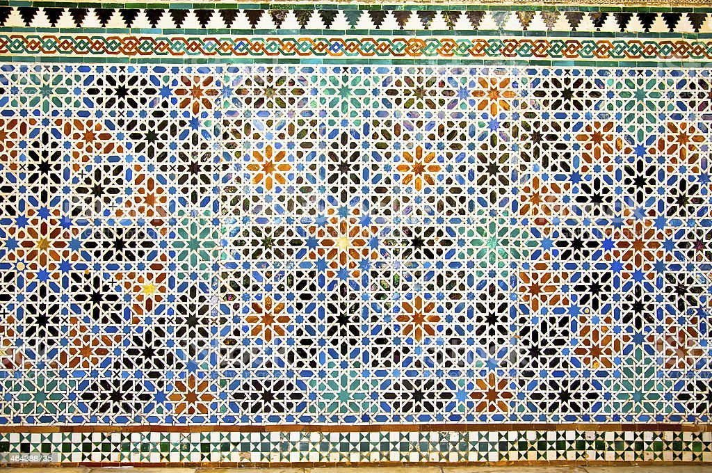 Tiled oriental mosaic wall in the Royal Alcazars of Seville stock photo