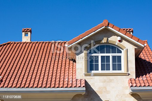 Red Tiled Ceramic Roof On House