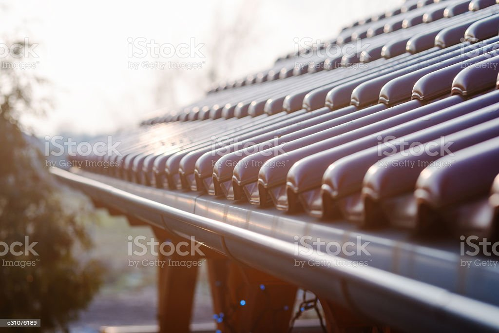 Tiled roof of wooden arbor stock photo