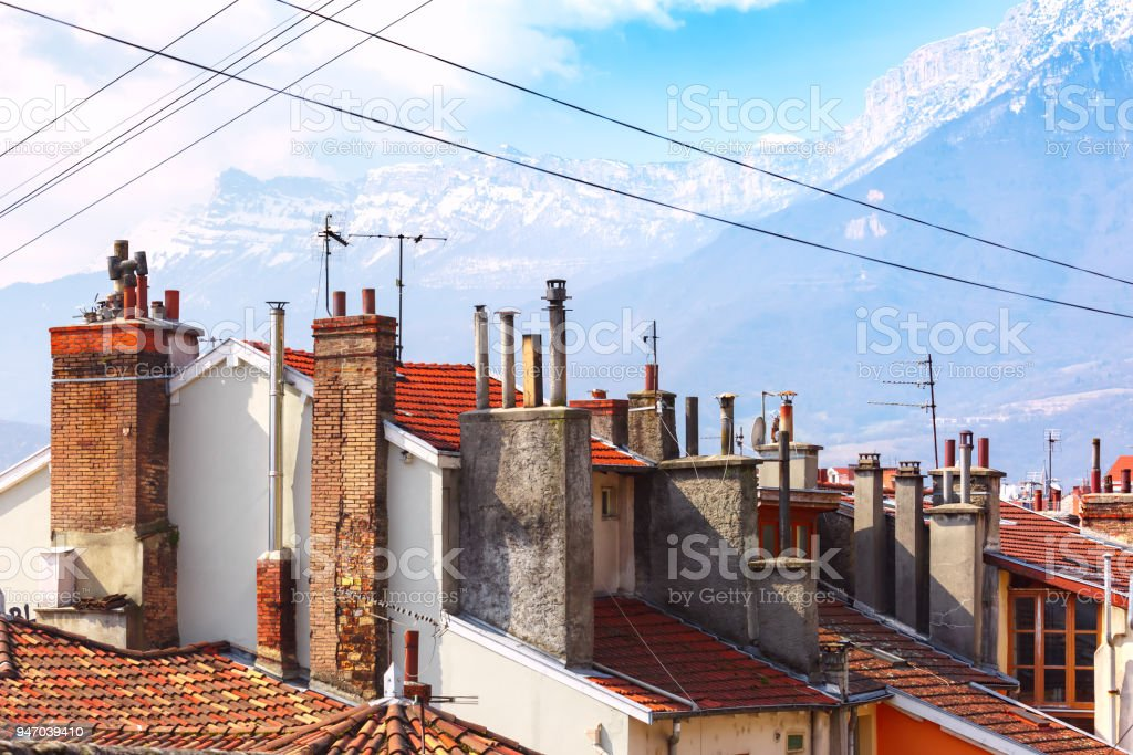 Tiled roofs with pipes Grenoble, France stock photo