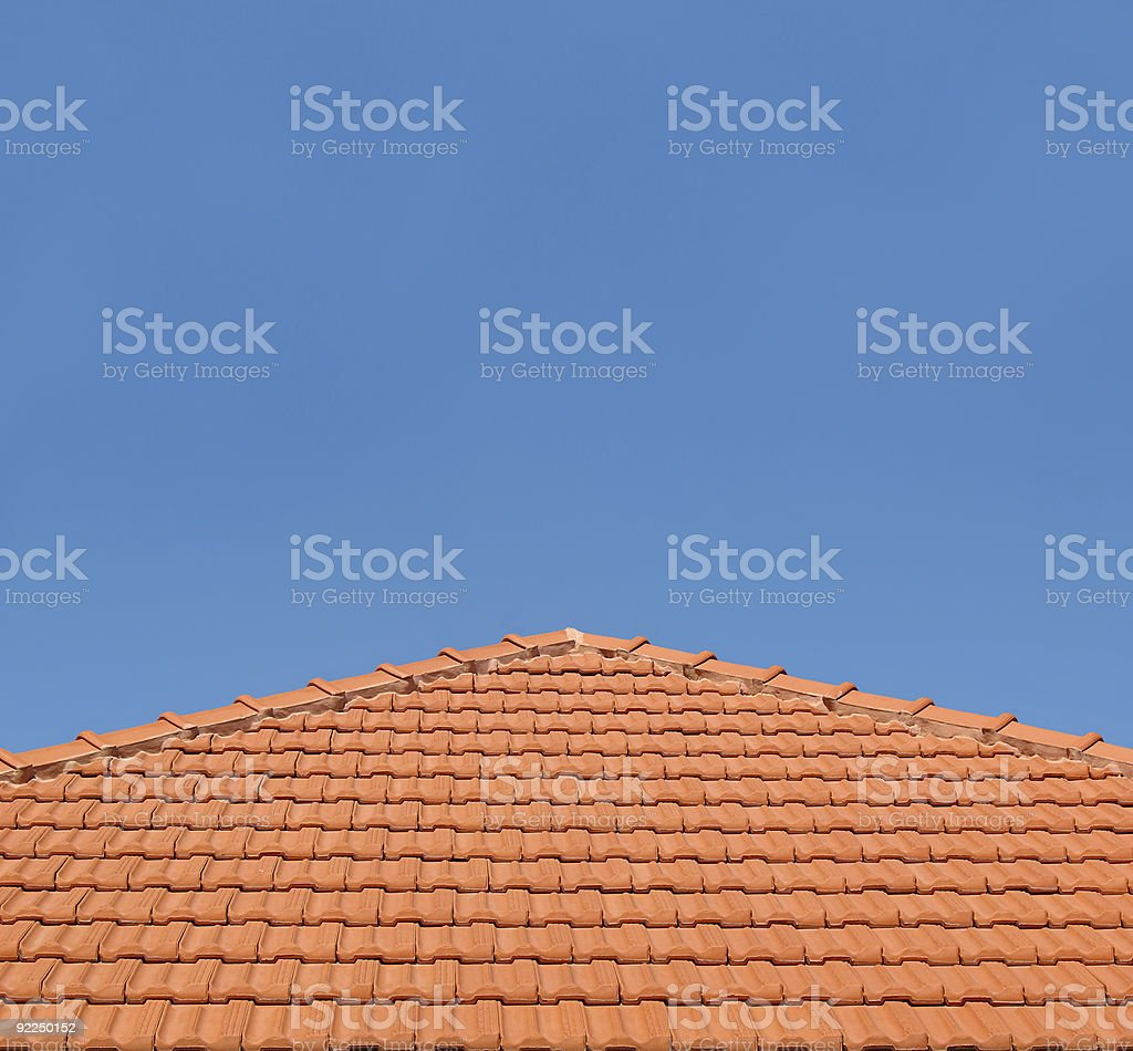 Tiled Rooftop on Blue Sky royalty-free stock photo