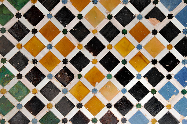 Tiled wall in Nasrid Palace,Alhambra,Granada,Andalucia,Spain Detail of a wall in the Nasrid Palace,Alhambra,Granada,Andalucia,Spain. palacios nazaries stock pictures, royalty-free photos & images