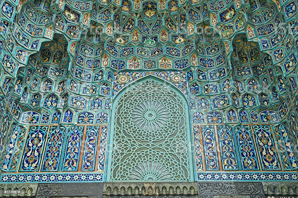 Tiled wall of green and blue Arabic-style mosaic stock photo