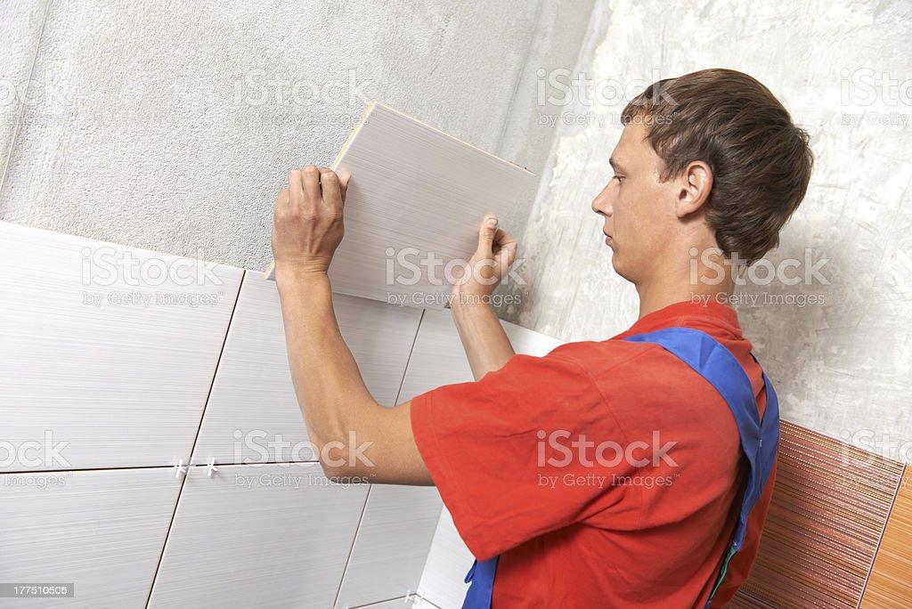tiler at home renovation work stock photo