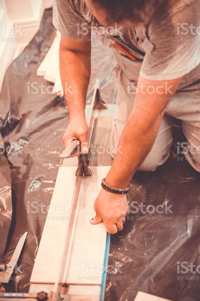 Tiler At Home Working With Floor Tile Cutting Stock Photo More