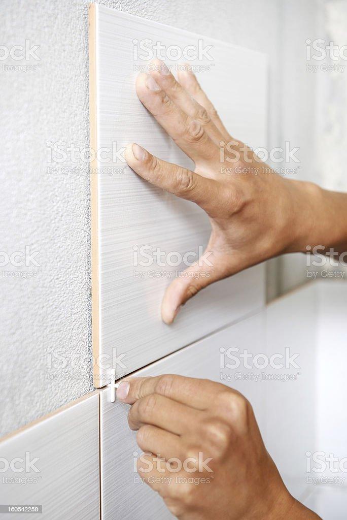 tiler hands at home renovation work stock photo