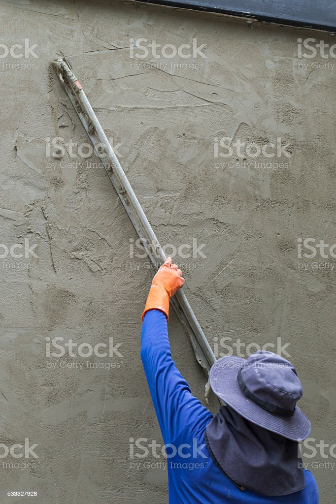 Tiler is working stock photo