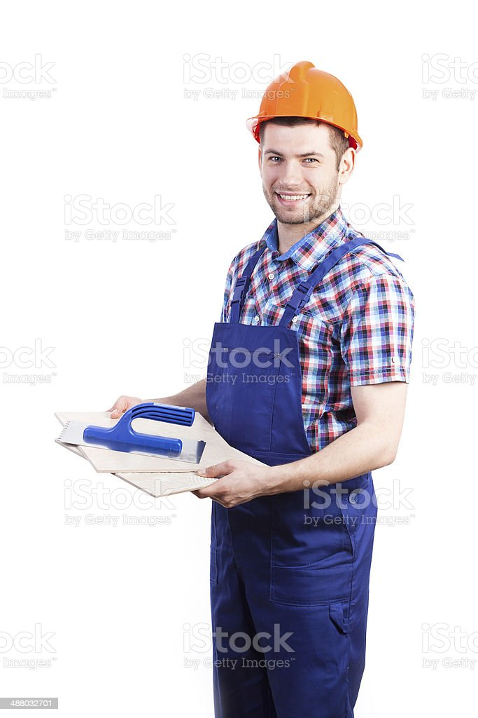 Tiler with tools stock photo