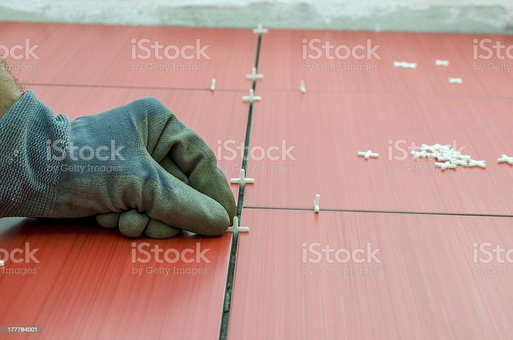Tiler's hand stock photo