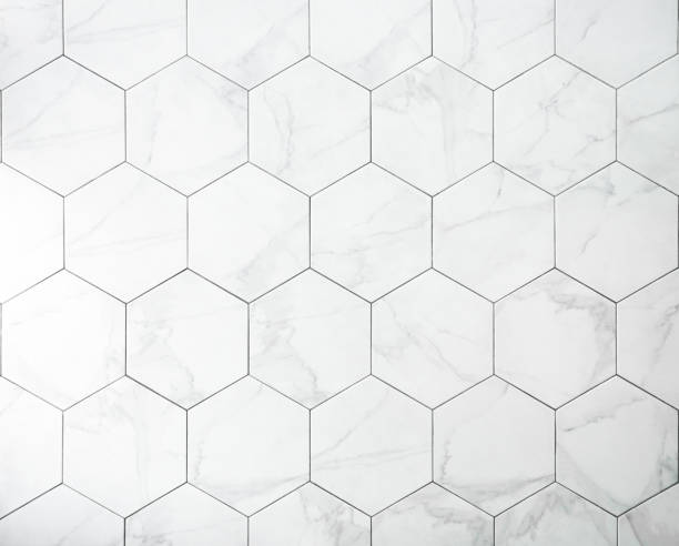 タイル。テクスチャと背景のための六角形のタイルを持つ白い大理石の壁。 - タイル ストックフォトと画像